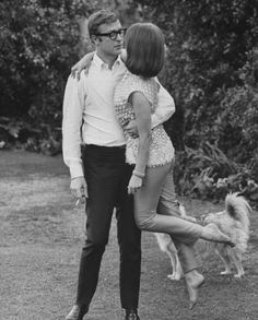 Michael Caine sweeping Natalie Wood off her feet. 1966.