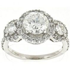 2.7 CT. Round Brilliant 18K White Gold Three Stone Diamond Ring.