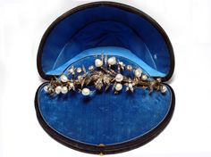 A yellow gold and silver tiara with old-cut diamonds and natural pearls. In original fitted box with a baronal crown. France, XIX century