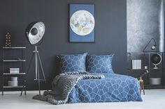 Photo about Industrial lamp next to bed with navy blue bedding against dark wall with moon poster in bedroom interior. Image of black, bedroom, furniture - 112677948 Retro Furniture, Recycled Furniture, Navy Blue Bedding, Loft Style Bedroom, Luxury Sheets, Bedroom Posters, Striped Walls, Industrial Bedroom, Cozy Bed