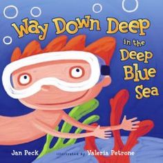 A child explores the treasures of the deep blue sea from the safety of a bathtub.