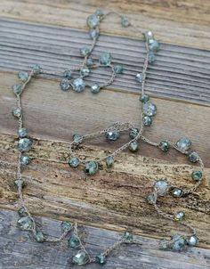 Opalescentaqua / tealcrystal glass beads are hand knotted in a…