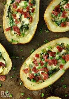 Spinach and Artichoke Loaded Potato Skins: creamy spinach artichoke dip + crispy loaded potato skins join forces to form the ultimate party appetizer!