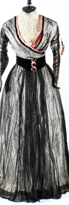 Day dress, ca. 1900s, of striped pewter silk with embroidered salmon pink detail. Bonham's