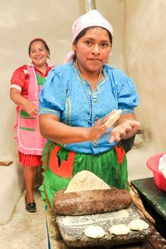 Honduran women making tortillas.