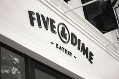 Five & Dime by Bravo Company for a restaurant/café in Singapore. A coin is used as a visual representation of the name. Five & Dime refers to a variety store where everything is sold for 5 or 10 cents. I loive the color palette, the logo, typeface selections... everything is so well designed and makes me want to be there! - exterior restaurant sign