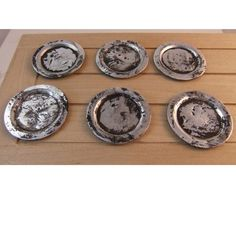 Set of 6 miniature old battered Tudor pewter plates by yewtree64