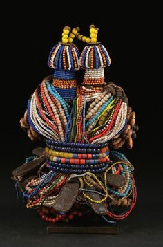 Africa | Fali doll from northern Cameroon | Wood, glass beads, leather, coins, cowrie shells, leather amulets, metal rings