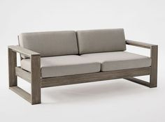The tailored cushions and boxy shape of this loveseat lend a fresh, modern air to your outdoor space.