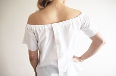 An off the shoulder top is this season's must have fashion piece to be seen in. I made this simple, white version from an old shirt T...