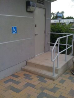 Handicap accessible stairs? I think a wheelchair could not get in that building at that door!!