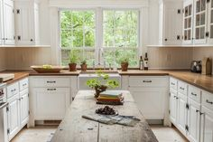 """Cooper painted the kitchen cabinetry in Farrow & Ball's Wimborne White. """"I think Mark and I drove Blythe a little crazy with some of this stuff,"""" she says. """"We could talk for three hours about the pros and cons of cabbage white over pure white."""""""