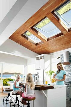 VELUX pine finish roof windows will look great in any room, including a kitchen extension like this one.