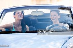 Stock Photo : Two women smiling in a car