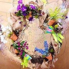 A wreath for the gardener in your life, complete with flower pots and gloves.  Created on a grapevine wreath with burlap ribbon accents.