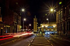The city of Goole at night, all lit up. The cars on the road are blurred because f slow shutter speed.