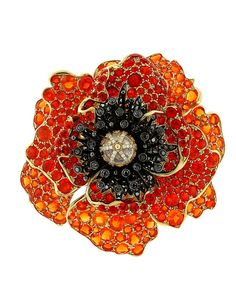 "This exquisite poppy is a symbol of sleep, dreams and peace and one of Paula Crevoshay's anatomically correct flower that will be in the one-woman exhibition titled ""Garden of Light at the Carnegie Museum of Natural History, which runs until August 2013"
