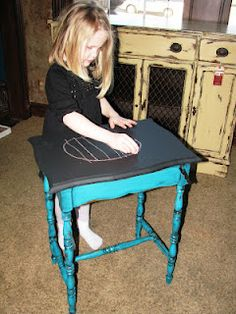 Turning a side table into a chalk board table. Good idea for the table the girls colored all over.
