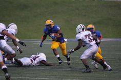 Marcus Wiltz carries the ball up the middle for a first down.  Marcus had 8 carries for 38 yards.