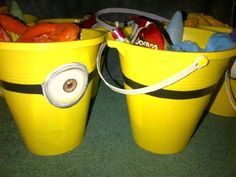 Despicable Me loot buckets.  Yellow pail, minion eyes printout, electrical tape for strap. Fill with candy. Yum!