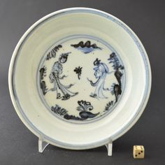 A Ming small Blue and White Porcelain dish, Hongzhi 1488 – 1505 or Zhengde 1506 – 1521 period, Jingdezhen kilns. Painted with two figures in a landscape, the reverse with scrolling lotus. www.orientalceramics.com