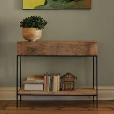 side table: like the combination of the bold wood with the lean steel.