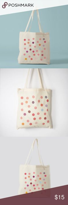 """Pink Polka Dot Tote Bag This delightful bag is covered in pink polka dots and hand made in Paris, France. The lightweight material makes it easy to carry this bag anywhere. Use it as a purse to hold all of your belongings or as an eco-friendly shopping bag. 100% ethically sourced cotton. 16.5"""" x 15"""" (without handles)Hand wash with cold water. This bag is from an online boutique I run which no longer sells this piece. It's handmade by an artisan called Bambou Chic. was selling for $20. Comes…"""