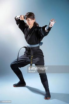 Aggressive female warrior standing in fighting stance