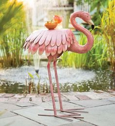 Handmade Metal Flamingo Side Table is pretty in pink and sports artistic details like layered feathers and a gracefully curved neck. Company will flock to it!