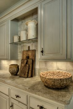 17th century French Stone Counters, Gray cabinets, antique bread boards