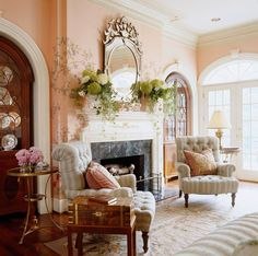 Cheerful living room decor. Love the architectural details - classic door and window trim, expansive crown molding, lovely fireplace mantel.  Very tastefully painted wall mural | Inviting Home Inspired