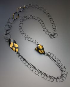Oxidized Floral Embrace: Judith Neugebauer: Gold & Silver Necklace - Artful Home