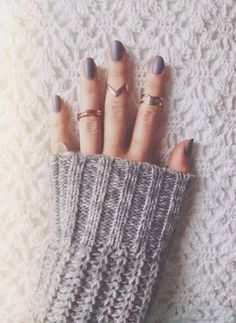 nails, rings, sweater