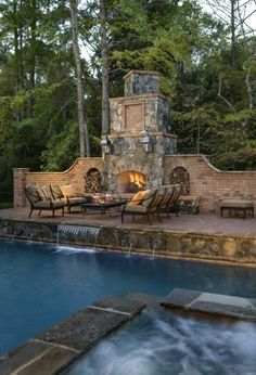 A huge fireplace seating area pool AND hot tub?! Sounds like the perfect backyard don't you think?