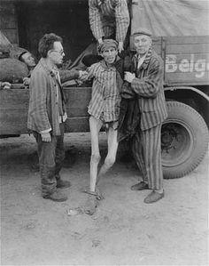 An emaciated survivor is helped into a truck that will transport him from the Woebbelin concentration camp to an American field hospital.