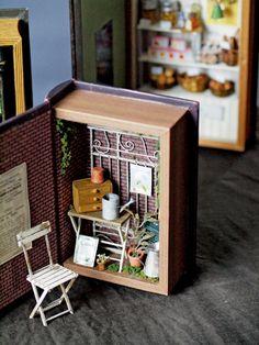 Clever ideas for small vitrine.  A shadow box un a book cover.