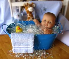 Great centerpiece idea for boy baby shower! @Seth Combs Combs and Kate Strickfaden you've got those bins ;)