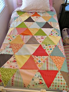 This simple and cheery quilt looks cutey patooty and seems like it'd be a quilt shape I could actually pull off.