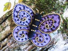 Butterfly of zippers and felt.