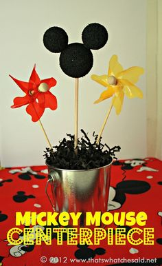 """Another super cute (and super inexpensive) project to add some Mickey Mouse fun to your party!  Items Needed: Small metal buckets or bins Dried Beans Small Doll Rods (1/4"""" or smaller) Styrofoam balls in 2 sizes (an assortment package at Dollar tree has enough for one centerpiece) Black Paint Embellishments (Pinwheels or star stakes …"""