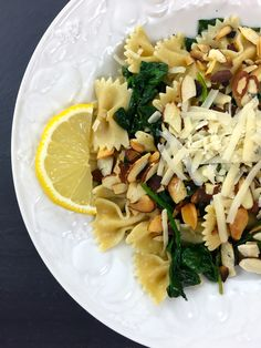 A healthy, quick, and light spinach lemon pasta dish with toasted almonds.