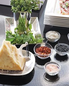 Have your favorite pizza delivered, and then embellish, embellish, embellish. DIY toppings set out in pretty little bowls look bountiful and give the impression that you spent at least some time in the kitchen. My favorite extras include a hunk of fresh Parmesan, basil and oregano bundled in a silver julep cup, red-pepper flakes, and a selection of exotic salts (I like to include black salt; white, large-flake finishing sea salt; French fleur de sel; and pink Hawaiian salt for a range of…