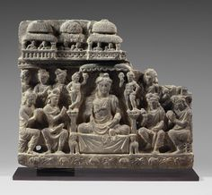 Gandharan Relief. Ancient region of Gandhara, 2nd-3rd century. Grey schist. Height: 15 inches (38 cm).