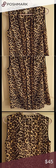 LEOPARD SILKY BLOUSE Beautiful 100% polyester blouse that feels & flows like silk. Tab collar w/ flattering V neck. Black trimmed placket descends from the V to the bottom The arm holes are also finished in black. Bought to wear under a black suit which never hsppened. NWOT. Tahari Tops Blouses