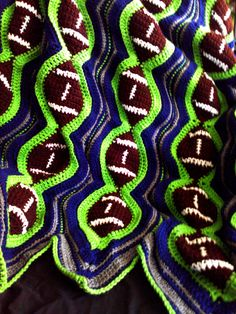 Crochet football blanket in Seattle SeaHawks colors. Wow this is beautiful