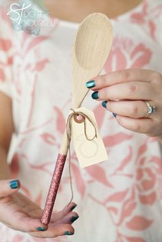 How to make these adorable glittered wooden spoons ~ safe to use and wash ~ they are the perfect bridal shower favors! #diywedding #somethingturquoise #bridalshower #favor
