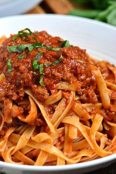 Rich Bolognese Sauce is perfect to serve over pasta. Bolognese Sauce is a meat based Italian sauce made with vegetables, wine, milk, beef and pork. Italian Dishes, Italian Recipes, Vegetarian Bolognese, Homemade Bolognese Sauce, Seafood Pasta Recipes, Pasta Sauces, Fish Recipes, Vegetarian Recipes, Kitchens