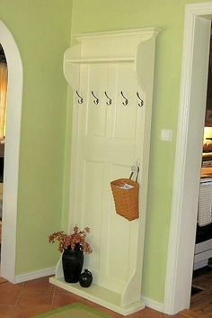 Turn old door into awesome coat rack.