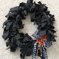 Halloween wreath made from a swim noodles and crepe paper