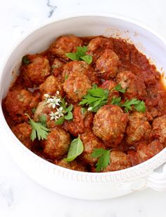 Ricotta Meatballs in Red Sauce in a White Ceramic Bowl